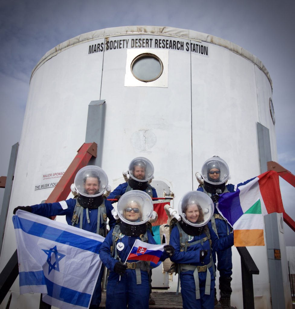 Crew-173-outside-the-MDRS-Habitat-Credit-Niamh-Shaw Niamh Shaw, elon musk, nasa, spacex, engineering, richard branson, communication, stem, astronaut, niamh, scientist, artist, perform, esa, polymath, broadcast, blue origin, virgin galactic, niamh shaw, space exploration, norah patten, zero g, irish astronaut, science communication, women in stem, roscosmos, female astronauts, jaxa, baikonur, irish engineering, ireland's first astronaut, multi disciplined, stem advocate, female space explorer, irelands first female astronaut, irelands first person in space, irish female activist, irish female polymath, irish female role model, irish female trailblazer, irish role models, irish space explorer, performer & communicator & space explorer, space advocate, stem communicator