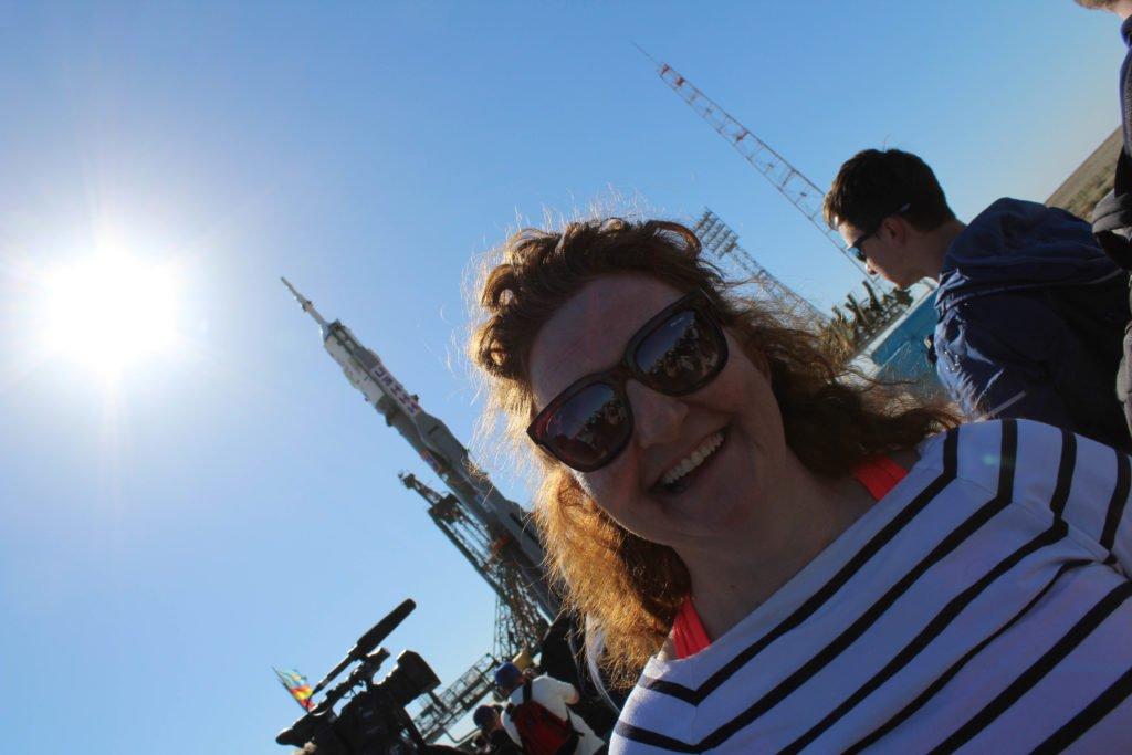 Niamh-at-Launchpad-1-with-Soyuz-MS-09-rocket-in-the-distance-©Space-Affairs-2018-1-1 Niamh Shaw, elon musk, nasa, spacex, engineering, richard branson, communication, stem, astronaut, niamh, scientist, artist, perform, esa, polymath, broadcast, blue origin, virgin galactic, niamh shaw, space exploration, norah patten, zero g, irish astronaut, science communication, women in stem, roscosmos, female astronauts, jaxa, baikonur, irish engineering, ireland's first astronaut, multi disciplined, stem advocate, female space explorer, irelands first female astronaut, irelands first person in space, irish female activist, irish female polymath, irish female role model, irish female trailblazer, irish role models, irish space explorer, performer & communicator & space explorer, space advocate, stem communicator